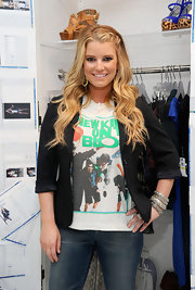 Jessica Simpson showed off her long curls while hitting her jeanswear sneak peak.