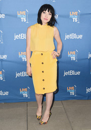 Carly Rae Jepsen pulled her vibrant look together with a pair of butterfly-print pumps.