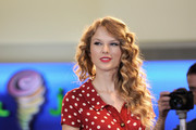 Singer Taylor Swift takes the stage prior to her live performance for JetBlue Airways at JFK Airport on October 27, 2010 in New York City.