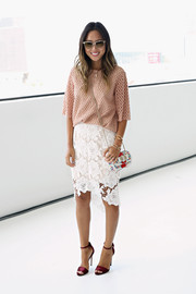 Aimee Song teamed her top with a feminine, elegant white lace pencil skirt.
