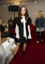 Cara Santana layered a brocade LBD over a white pussybow blouse for the Jill Stuart fashion show.