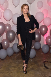 Diane Kruger was svelte and stylish in a studded black catsuit at the Jimmy Choo 20th anniversary event.