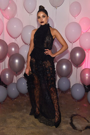 Olivia Culpo was sexy-goth in a sheer black lace gown at the Jimmy Choo 20th anniversary event.