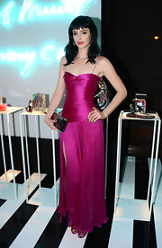 Krysten smoldered in a gathered hot pink dress with tiny spaghetti straps at the Jimmy Choo collab celebration.