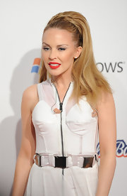 Pop star Kylie Minogue sported a high ponytial full of volume and depth. Her voluminous look was completed with twisted tendrils wrapped at the base of her 'do.