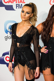 Perrie Edwards layered a beaded and feathered cover-up over a bralette and bikini bottoms for the Jingle Bell Ball.