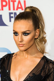 Perrie Edwards channeled Cleopatra with her heavily rimmed eyes.