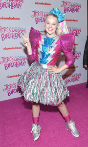 JoJo Siwa chose a fuschia, silver, and blue sequined top with pointy shoulders for her 16th birthday celebration.