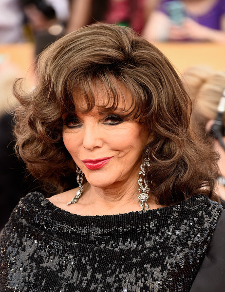Joan Collins Medium Curls with Bangs [hair,face,hairstyle,hair coloring,blond,layered hair,eyebrow,brown hair,chin,beauty,arrivals,joan collins,screen actors guild awards,los angeles,california,the shrine auditorium]