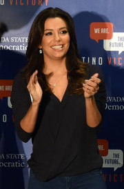 Eva Longoria was casual-chic in a black wrap top while campaigning for Nevada Democrats.
