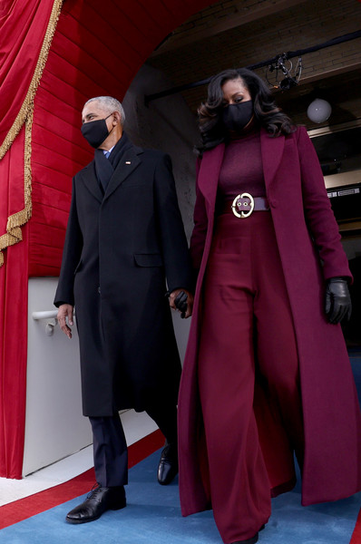 Michelle Obama looked stylish in a burgundy wool coat by Sergio Hudson during Joe Biden's inauguration.