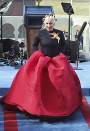 Lady Gaga went full-on glam in a midnight-blue and red Schiaparelli Couture gown with a gold dove brooch during Joe Biden's inauguration.