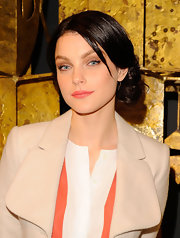 Jessica Stam wore her ultra-shiny locks in a loose side bun while attending the Joe Fresh flagship store opening in NYC.