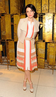 Jessica Stam sealed off her spring-chic ensemble with a pair of white ankle-strap platform pumps by Tod's.