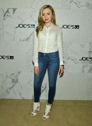 Peyton List kept it classic in a white button-down, made chicer with the addition of fringe stripes, during the launch of the 2016 Joe's Jeans campaign.