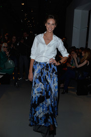 Ophelie Meunier looked effortlessly chic in this white button down and long colorful skirt.