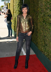 Tamara Taylor opted for a metallic, see-through button down for her look at the John Varvatos Stuart House Benefit.