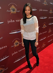 Zoe Saldana kept her red carpet style neutral in a sheer striped sweater and black skinny jeans.