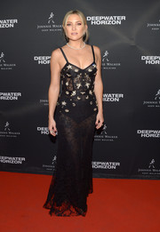 Kate Hudson went risque in a sheer black corset gown by Alexander McQueen at the Toronto premiere of 'Deepwater Horizon.'