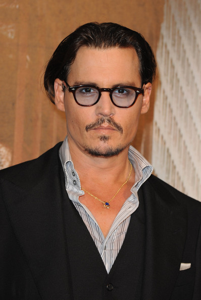 "Johnny Depp Hair. U.S Actor Johnny Depp attends the ""Public Enemies"" film"