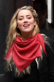Amber Heard accessorized with a dotted red scarf during Johnny Depp's libel trial.