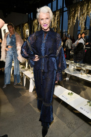 Maye Musk struck a pose at the Jonathan Simkhai fashion show wearing a navy zip-up lace top from the label.