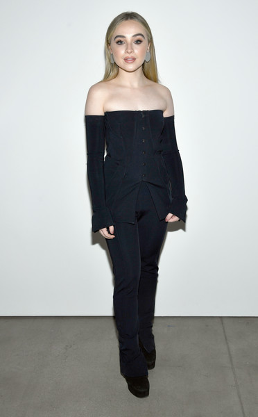 Sabrina Carpenter was trendy in a fitted navy off-the-shoulder top by Jonathan Simkhai during the brand's fashion show.