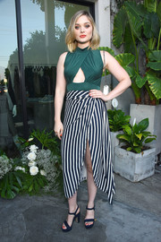 Bella Heathcote paired her top with a black-and-white striped midi skirt.
