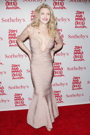 Courtney Love looked va-va-voom in a mauve bandage mermaid gown by Herve Leger during Jony and Marc's (Red) Auction.