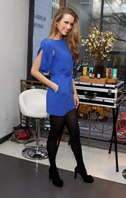 Petra Nemcova looked ultra-chic wearing this blue silk dress at the Doing a Good Thing is Beautiful event.