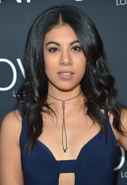 Chrissie Fit sported a plumped-up 'do with a center part and spiral curls during the Jovani LA flagship opening.