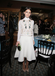 Miroslava Duma donned a red carpet-worth embroidered white turtleneck for the Paris Fashion Week dinner.