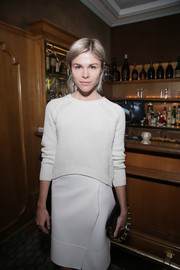 Emily Weiss went all white with this crewneck sweater and pencil skirt combo at the Paris Fashion Week dinner.