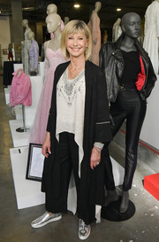Olivia Newton-John finished off her ensemble with a pair of embellished silver slip-ons.