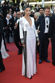 Adriana Lima chose a plunging white Prada gown with black embellishments for the Cannes premiere of 'Julieta.'