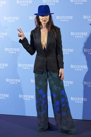 Juliette Lewis flashed some skin in a black blazer worn sans shirt underneath while attending the Belvedere Vodka party in Madrid.
