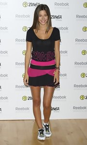 Malena Costa launched Zumba Fitness wearing a comfy tee and skirt team up.
