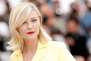 Kirsten Dunst wore a retro-cute flip at the Cannes jury photocall.