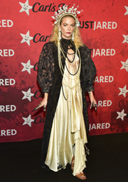 Jaime King layered a black coat over her gown for added drama.