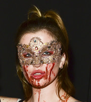 Ireland Baldwin attended Just Jared's Halloween party with blood smeared all over her face.