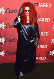 Kelly Osbourne channeled Myrtle Snow in a long navy wrap gown at Just Jared's Halloween party.
