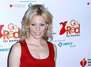 Elizabeth Banks attended the premiere party for 'Just A Little Heart Attack' with her shoulder-length locks full of body and waves. To try her look, backcomb hair through the crown and curl ends with a medium-barreled curling iron. Finish the look by using fingers to smooth and lightly tousle curls.