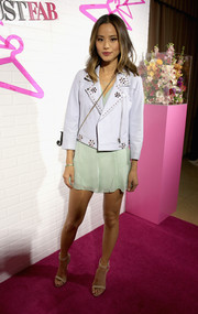 Jamie Chung was edgy-cute in a studded white leather jacket layered over a mint romper during the JustFab ready-to-wear launch.