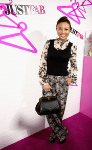 Jeannie Mai wore a black tank top over a print blouse for the JustFab ready-to-wear launch.