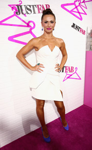 Karina Smirnoff looked very modern in an architectural white strapless mini during the JustFab ready-to-wear launch.