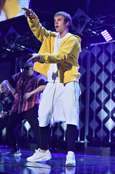 Justin Bieber Long Shorts [jingle ball 2016,show,performance,entertainment,performing arts,stage,yellow,event,public event,music,performance art,music artist,justin bieber,madison square garden,new york new york,z100]