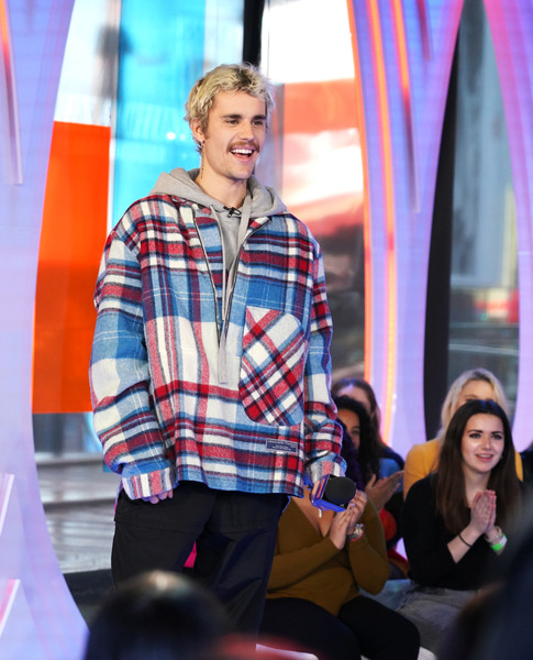 Justin Bieber layered a half-zip flannel shirt over a gray hoodie for MTV's 'Fresh Out Live.'
