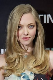 Amanda Seyfried kept her makeup soft and light with just a touch of lipgloss at a photocall for 'In Time.'