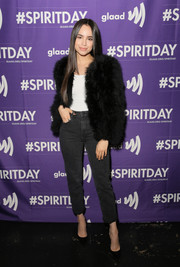 Sofia Carson dressed up her jeans with a black fur jacket.