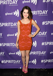 Laura Marano showed off her super-slim figure in a body-con red mini dress at the 'Believer' Spirit Day concert.